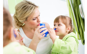 mother and kid with neti pot ready for nasal irrigation or douch
